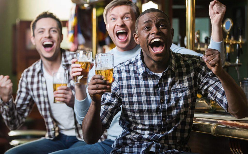 Three men at a sports bar