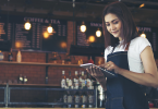 Restaurant woman employee holding a tablet